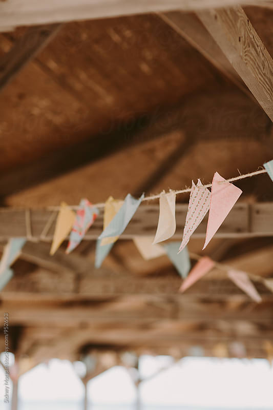 Pastel Flags Hanging  by Sidney Morgan for Stocksy United