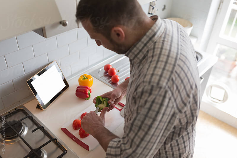 Man Cooking in the Kitchen with a Digital Tablet  by Mattia Pelizzari for Stocksy United
