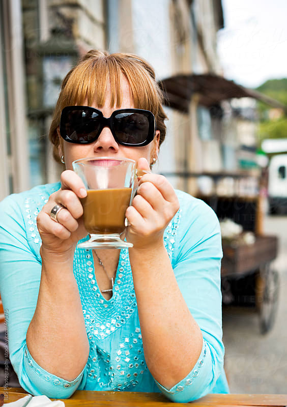 Woman having coffee. by IDS Photography for Stocksy United
