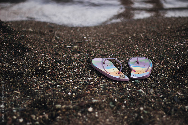 Flip flops on the sand by Jovana Rikalo for Stocksy United