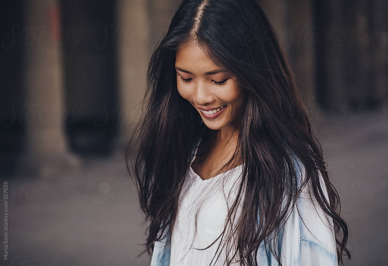 Beautiful shy Asian woman.  by Marija Savic for Stocksy United