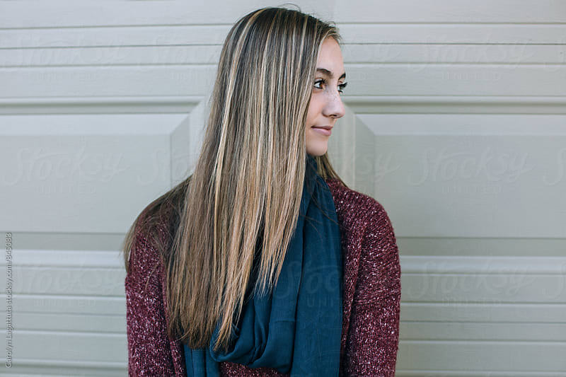 Profile of a beautiful teenage girl with long, blonde hair by Carolyn Lagattuta for Stocksy United
