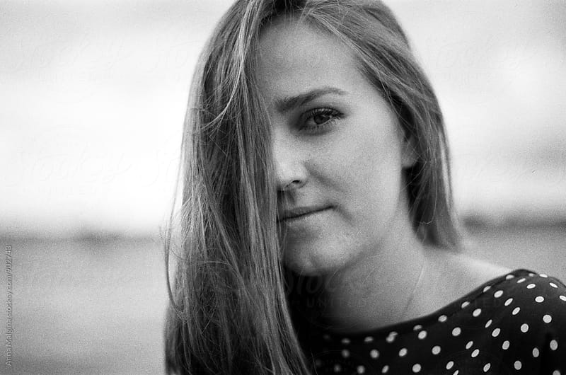 A black and white film portrait of young beautiful woman by Anna Malgina for Stocksy United