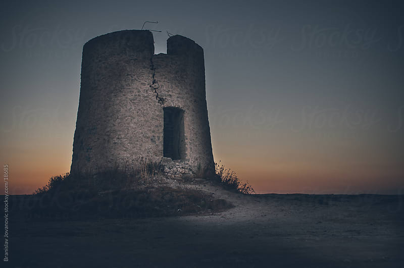 Ruined tower on the beach by Branislav Jovanović for Stocksy United