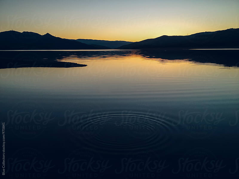 Ripple in a lake at sunset by Jordi Rulló for Stocksy United