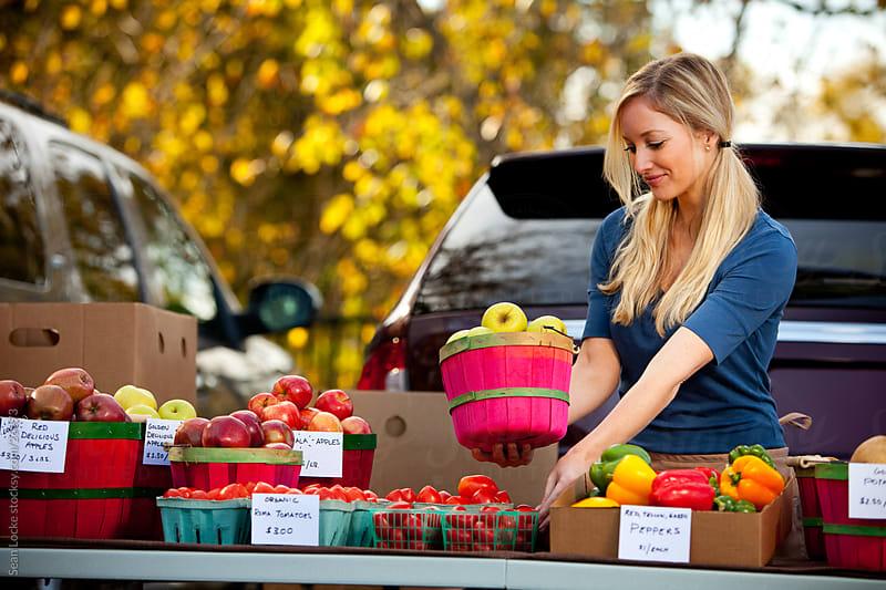 Farmer's Market: Farmer Setting Out Fruit Baskets by Sean Locke for Stocksy United