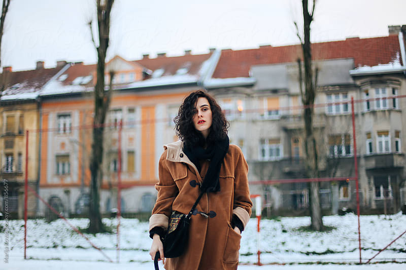 Beautiful curly woman outdoor  by Marija Kovac for Stocksy United