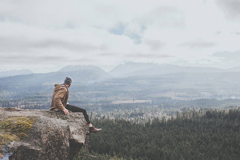 Sitting on a cliff on Little Mountain by Luke Gram for Stocksy United