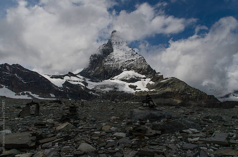 The Matterhorn surrounded by cloud by Neil Warburton for Stocksy United