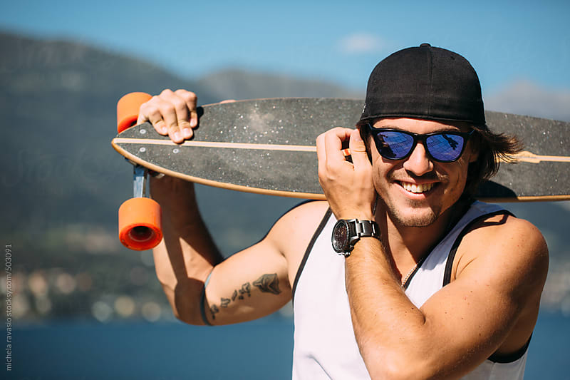 Portrait of a handsome smiling skater by michela ravasio for Stocksy United