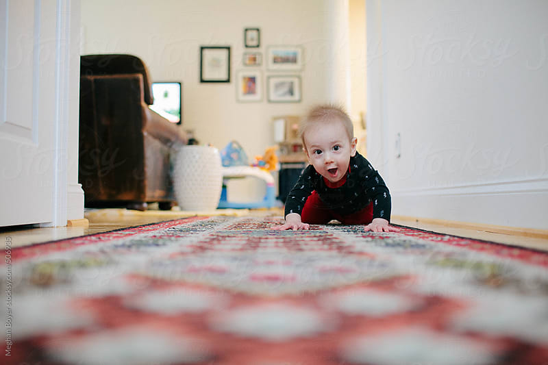 Learning to crawl down the hallway by Meghan Boyer for Stocksy United