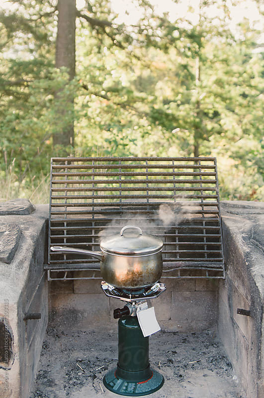 pot on camp stove by Deirdre Malfatto for Stocksy United
