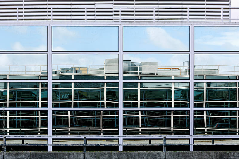 Reflections in an office window by Paul Phillips for Stocksy United