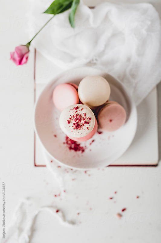 Vanilla and raspberry macarons by Tatjana Zlatkovic for Stocksy United