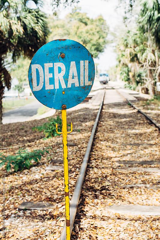Derailing warning sign on a railroad by Gabriel (Gabi) Bucataru for Stocksy United