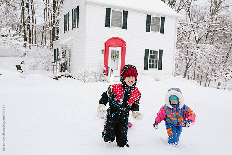 two girls outside on a snow day by Brian Powell for Stocksy United