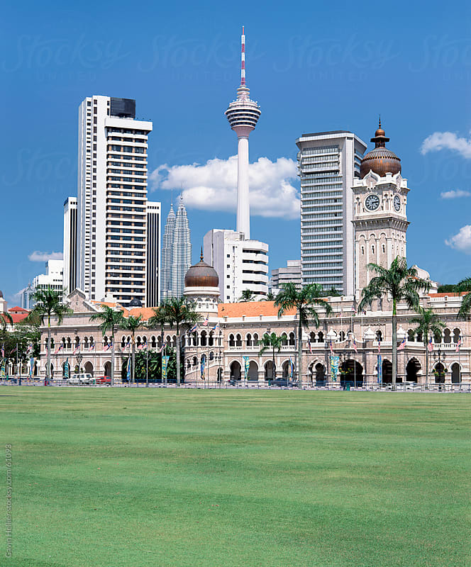 Merdaka Square including the Sultan Abdul Samad Building and the Petronas Towers, Kuala Lumpur, Mala by Gavin Hellier for Stocksy United