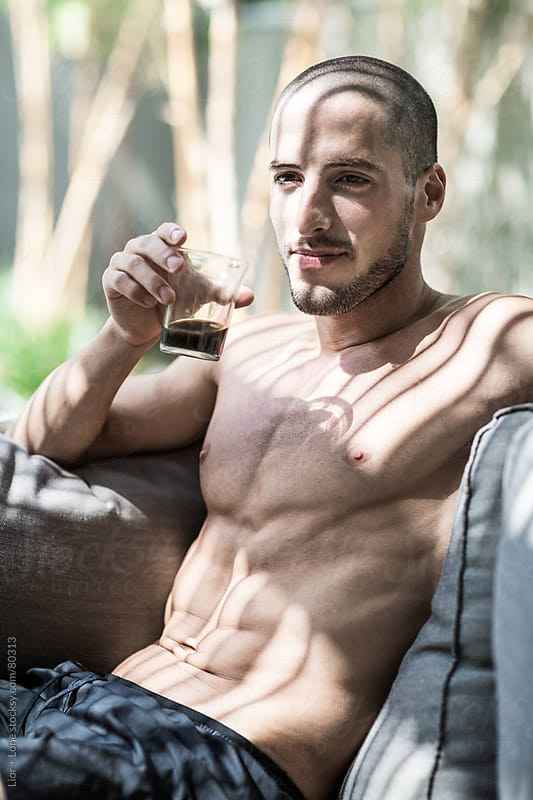 Young handsome athlete drinking coffee by Lior + Lone for Stocksy United