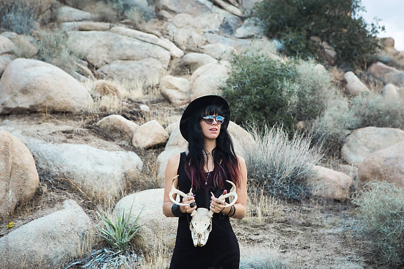 Witchy Woman Holding Deer Skull by MEGHAN PINSONNEAULT for Stocksy United