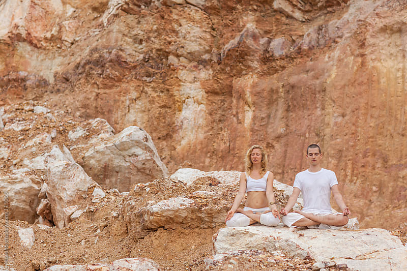Two People Meditating in the Rocky Surrounding by Mosuno for Stocksy United