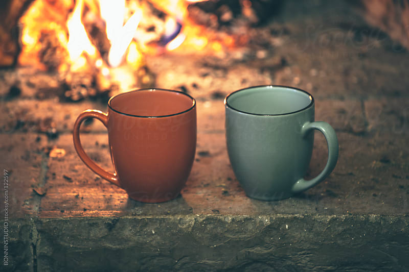 Fireplace with two hot cups.  by BONNINSTUDIO for Stocksy United