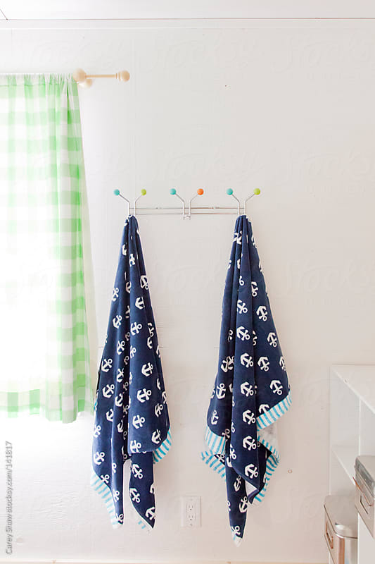 Hanging towels by Carey Shaw for Stocksy United