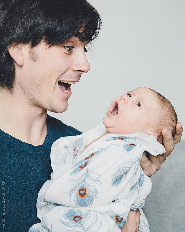 Baby & daddy singing together by Ania Boniecka for Stocksy United