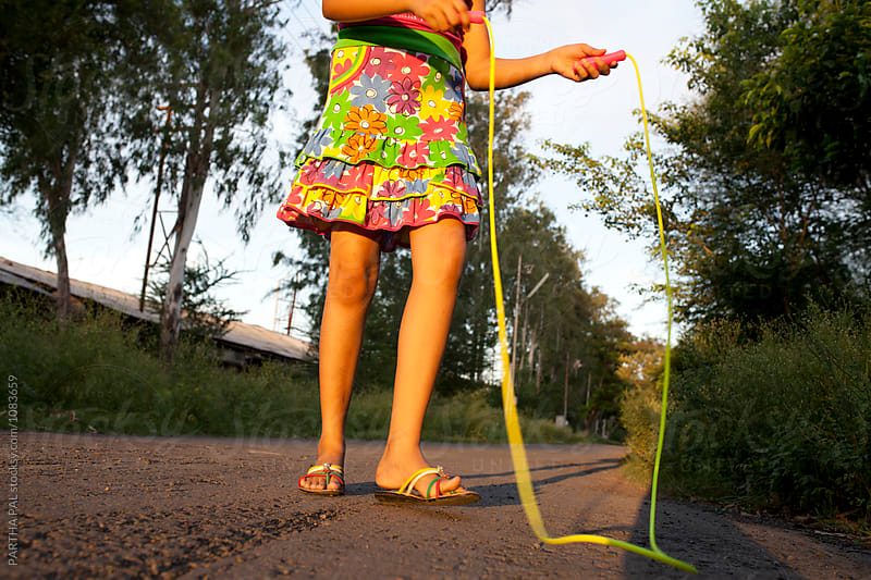Teenage girl takes a break from plying with Jumping Rope by PARTHA PAL for Stocksy United