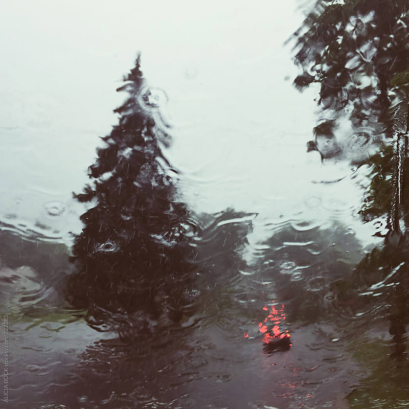 Abstract View Through A Car Windshield During A Very Heavy Rainstorm by ALICIA BOCK for Stocksy United