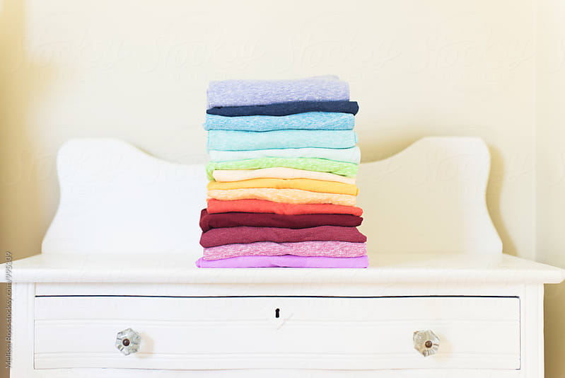 Stack of colorful shirts by Melissa Ross for Stocksy United
