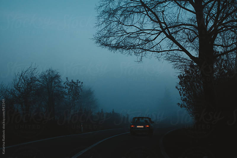 Car On the Road in a Dark Blue Night by Katarina Radovic for Stocksy United