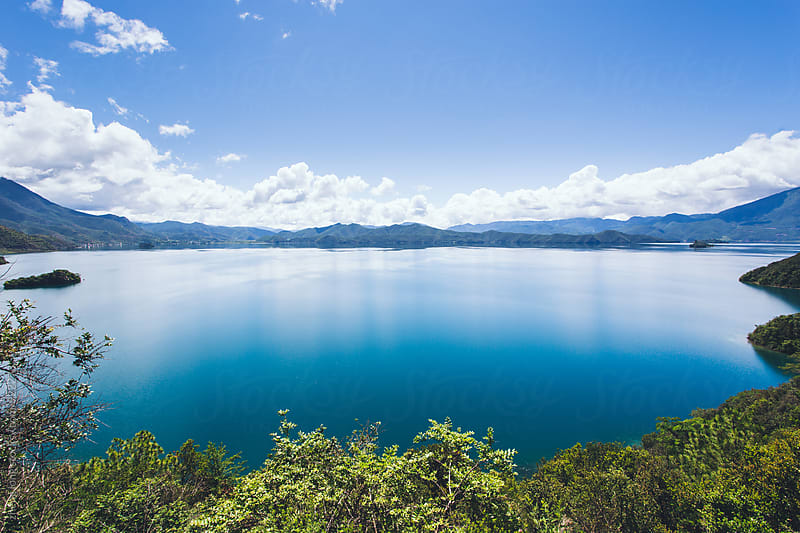 Lugu lake in Yunnan Province,China by zheng long for Stocksy United
