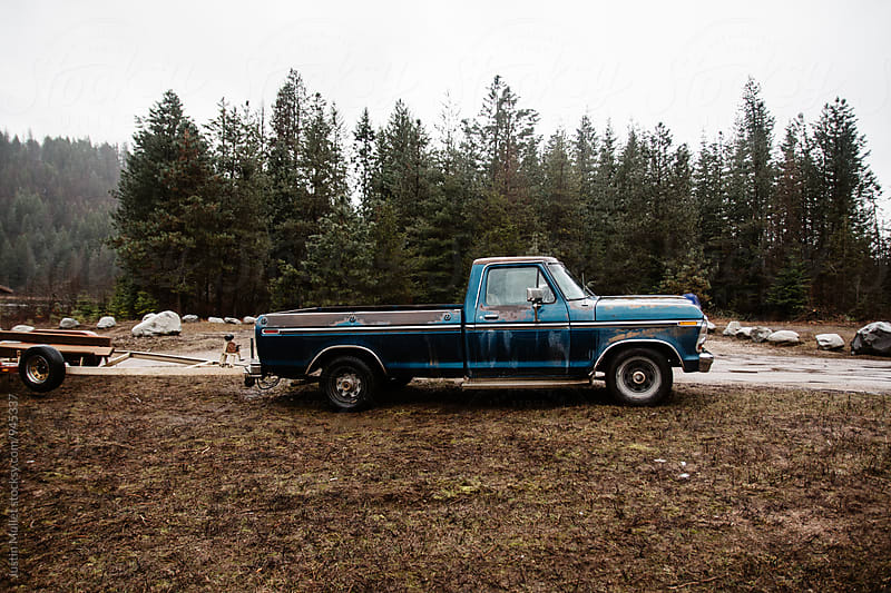 Old truck parked at a boat launch in North Idaho by Justin Mullet for Stocksy United