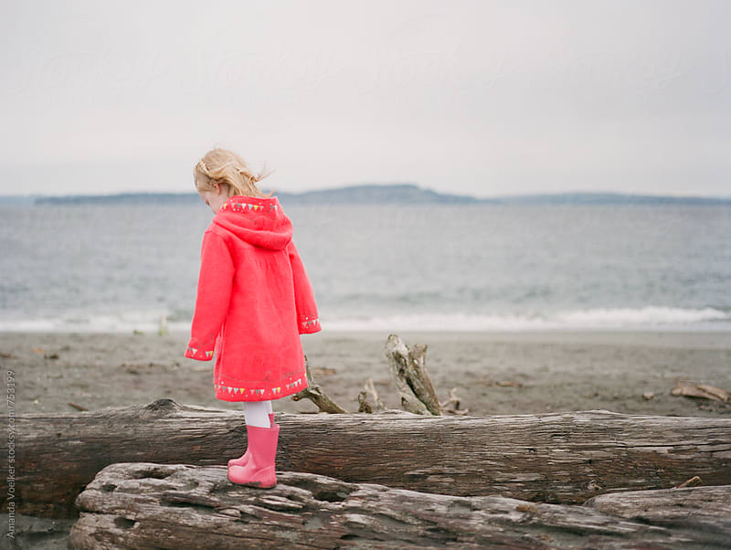 Little Girl with Blonde Hair at the Beach on a Chilly Day by Amanda Voelker for Stocksy United