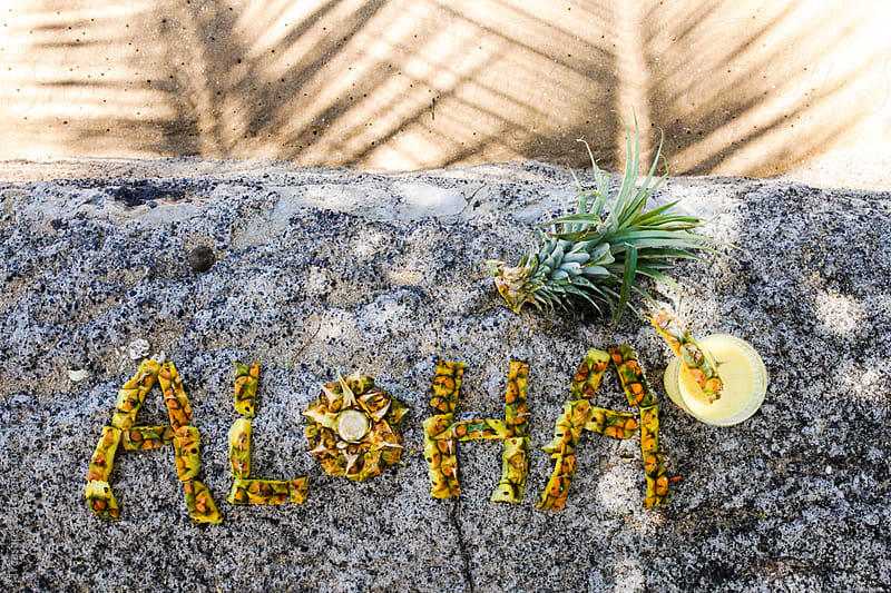aloha spelled out in pineapple slices by Treasures & Travels for Stocksy United
