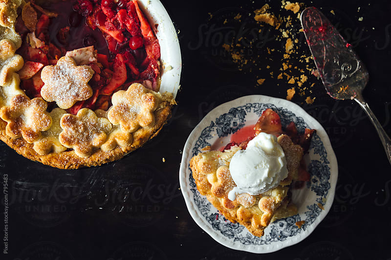 Pie with fruits and marzipan served with ice cream by Pixel Stories for Stocksy United