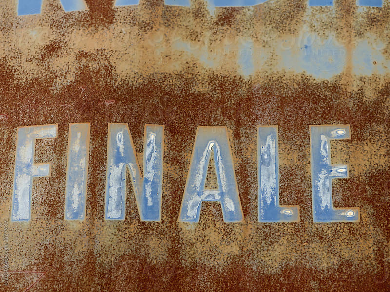 Finale text on rusty metal surface by rolfo for Stocksy United