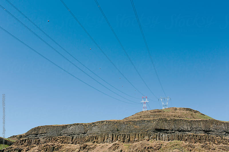 high voltage power lines near hydroelectric dam by Cameron Zegers for Stocksy United