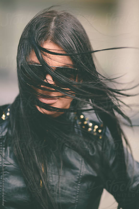 Closeup of young woman with sunglasses by Alexey Kuzma for Stocksy United