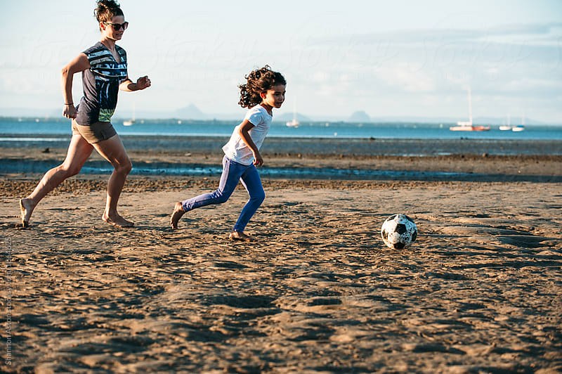 Girl runs on beach. by Shannon Aston for Stocksy United