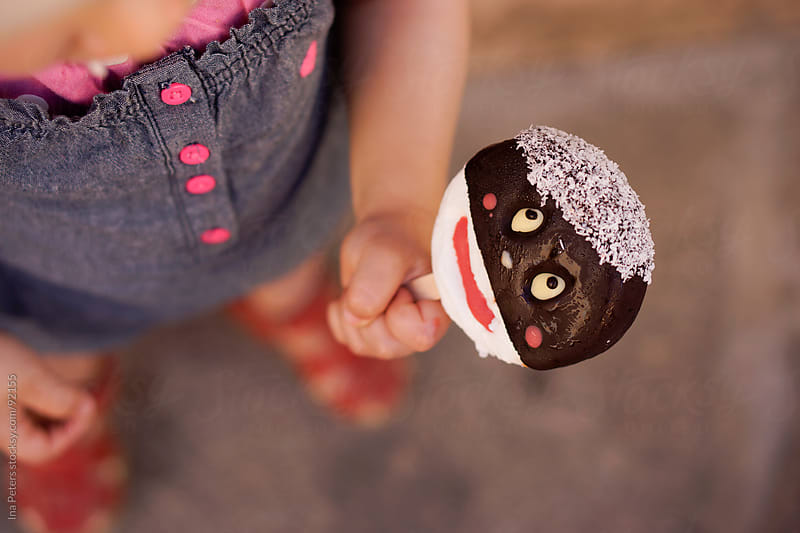 Little Girl With Ice Cream and Hat by Ina Peters for Stocksy United