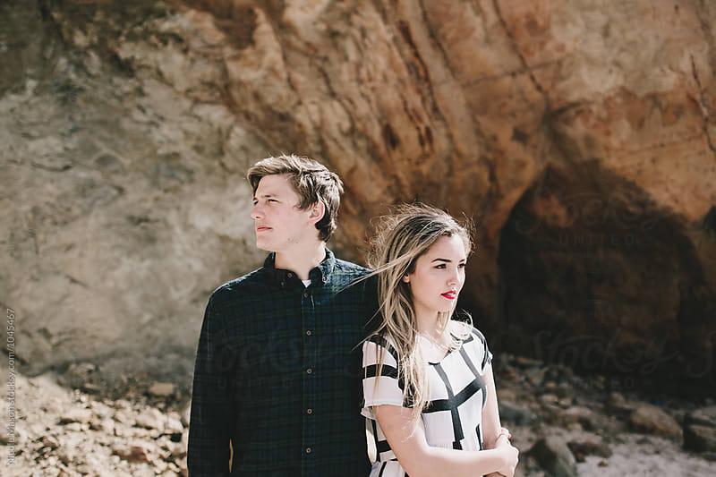 young fashionable couple on oregon coast by Nicole Mason for Stocksy United