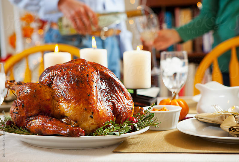 Thanksgiving: Roast Turkey Sits On Table To Rest by Sean Locke for Stocksy United
