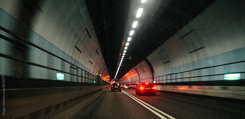 Cars in a tunnel by kkgas for Stocksy United