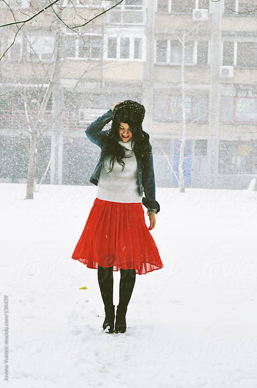 girl on snow by Jovana Vukotic for Stocksy United
