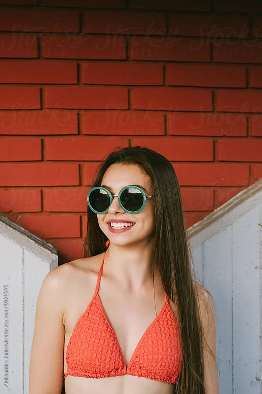 Portrait of Smiling Brunette with Sunglasses by Aleksandra Jankovic for Stocksy United