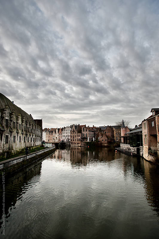 Landscape of Gent (Belgium) with a canal and typical houses with Flemish architecture by Jean-Claude Manfredi for Stocksy United