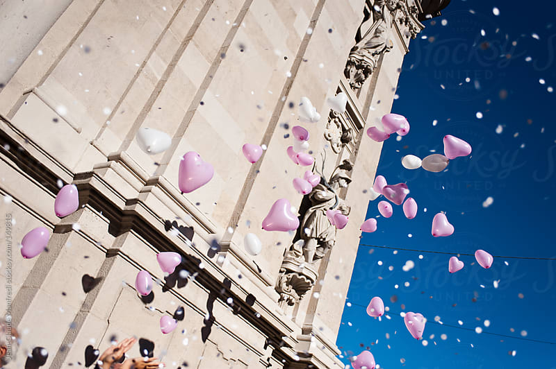 Heart balloons in the air by Jean-Claude Manfredi for Stocksy United