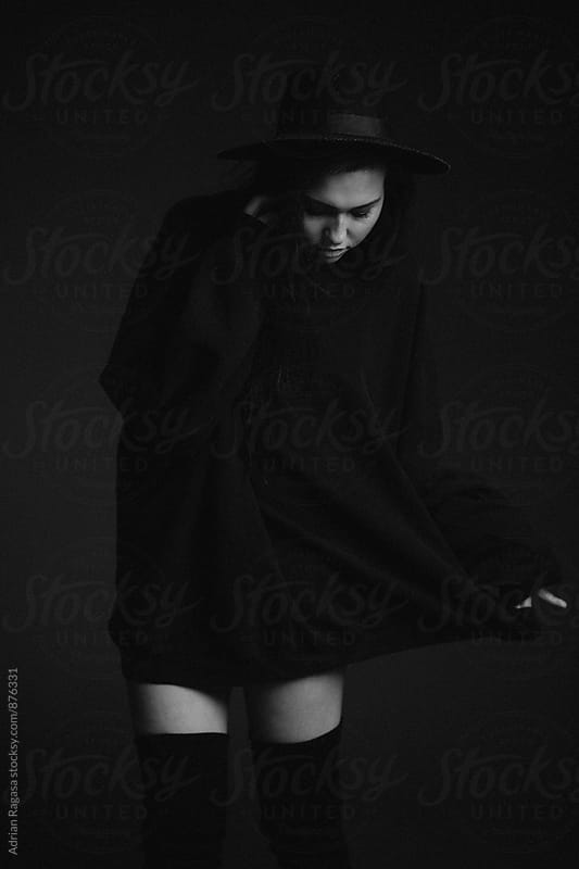 Woman in Oversized Sweater & Hat by Adrian Ragasa for Stocksy United