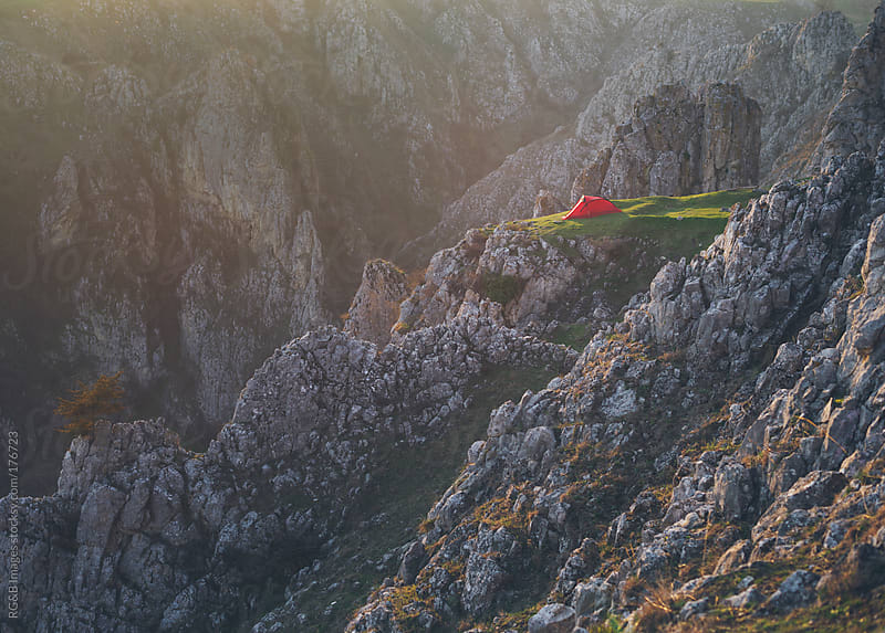 Red camping tent   by RG&B Images for Stocksy United
